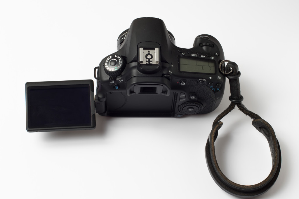 This waist-level viewfinder swivels to the side. Others are hinged to flip upward from the back of the camera