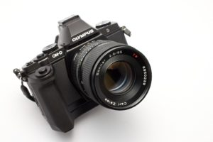 One of my 1990s Zeiss lenses for Contax mounted on an Olympus OM-D mirrorless body.