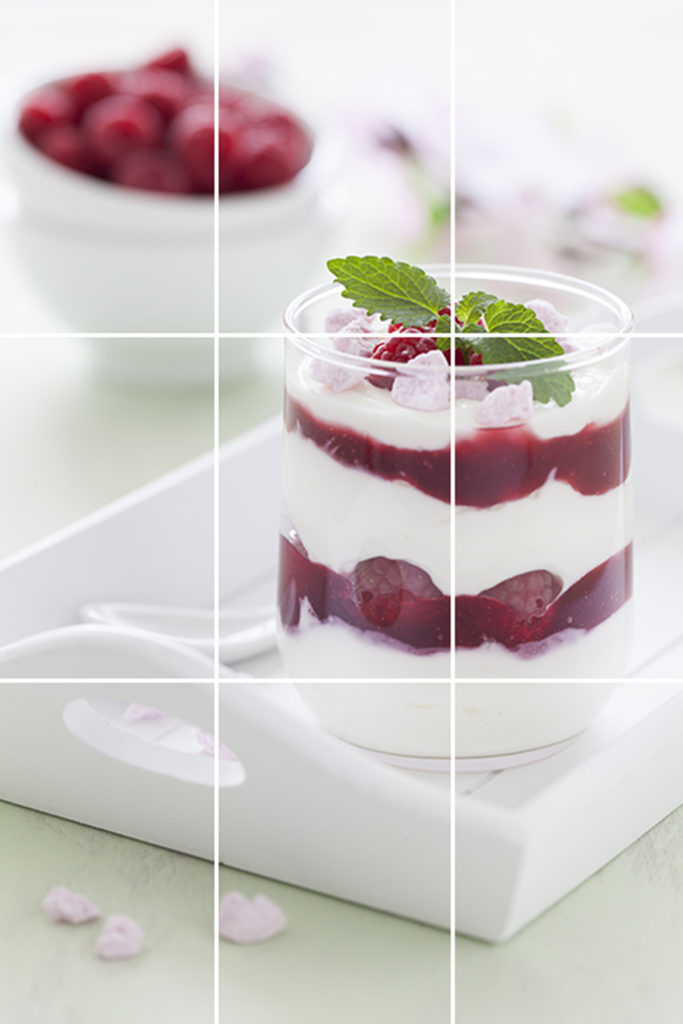 In this photo of a raspberry trifle, I positioned the dessert on the right-hand vertical line with the mint leaf placed at the top-right intersection.