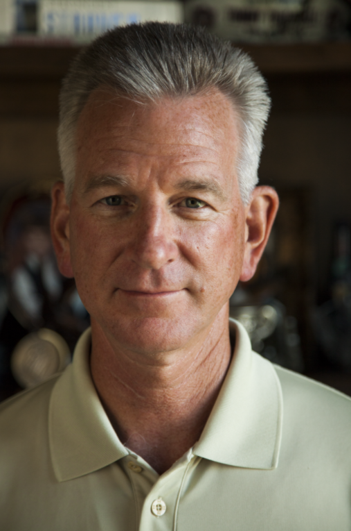 6 To provide NCAA football coach Tommy Tuberville a masculine look based on light alone, I turned him parallel to the large window in his office. This created a soft light that transitioned into darker shadow straight down the middle of his face. ISO 800; 1/100 sec.; f/4; 105mm. © Jerod Foster