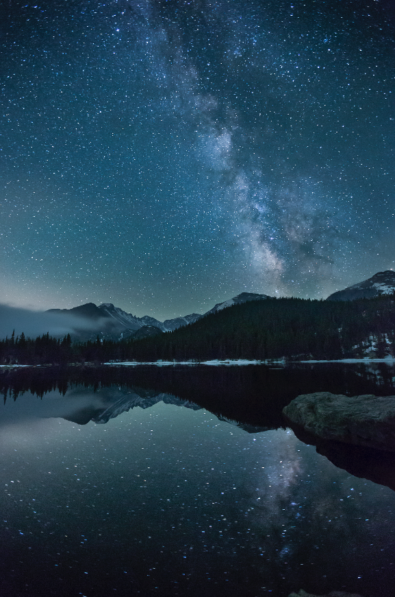 The Milky Way and Longs Peak reflected in Bear Lake, Rocky Mountain National Park, Colorado. I shot two frames with a 16mm lens at f/2.8, ISO 6400, and merged them with the modified Rembrandt Solution. I exposed the sky frame for 30 seconds and the land frame for 90 seconds.